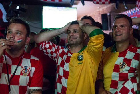 Croatian fans Mario Pincic (c) and Gordan Maricevic (r) pictured in the Astoria neighborhood of Queens, New York during the opening match. The neighborhood houses large Croatian and Brazilian communities. Photograph: Andrew Kelly/Reuters
