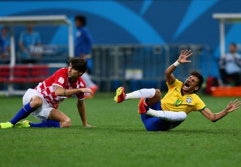 Neymar of Brazil falls after a foul by Dejan Lovren of Croatia in the second half. Photograph: Kevin Cox/Getty Images