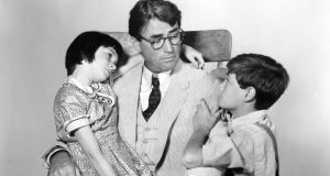Best dad ever?: Gregory Peck  as Atticus Finch with Mary Badham as Scout and Phillip Alford as Jem in To Kill A Mockingbird, directed by Robert Mulligan, and adapted from the novel by Harper Lee. Photograph: Silver Screen Collection/Getty Images