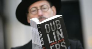 John Shevlin, dressed as James Joyce at the launch of Dublin; One City, One Book in 2012 when Dubliners was the choice. Photograph: Dara Mac Dónaill