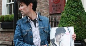 Ian O'Riordan with his signed album at the spot on Dublin's Leeson Street where he met Dylan in 1995
