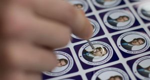 Stamps depicting Spain's Prince Felipe as future king are covered with gum for keychains at a factory in Colmenar Viejo. Photograph: Gonzalo Arroyo Moreno/Getty Images