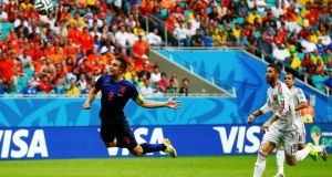 Robin van Persie scores the Netherlands' opening goal during the World Cup Group B match against Spain  at the Fonte Nova Arena in Salvador. Photograph: Michael Dalder/Reuters