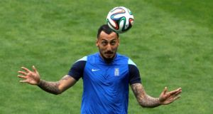 Fulham's Kostas Mitroglou faces a race to be fit for Saturday's Group C opener against Colombia