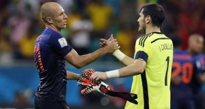 Arjen Roben of the Netherlands (left) shakes hands with goalkeeper Iker Casillas of Spain their Group B match at the Arena Fonte Nova in Natal. Photograph: EPA