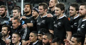 Richie McCaw celebrates with his New Zealand teammates after their win over England. Photograph: Martin Hunter/Getty Images