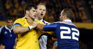 Nathan Charles  scuffles with France's Frederic Michalak during final minutes of their second test in Melbourne. Photograph: Jason Reed/Reuters