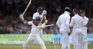 Kumar Sangakkara of Sri Lanka celebrates reaching his century with teammate Mahela Jayawardena during day three of the first  Test against England  at Lord's. Photograph: Gareth Copley/Getty Images