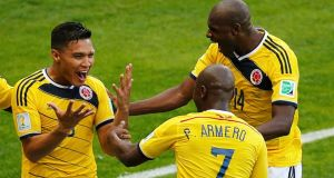 Colombia's Teofilo Gutierrez (left) celebrates with teammates Pablo Armero and Victor Ibarbo (right) after scoring the second  against Greece at the Mineirao stadium in Belo Horizonte. Photograph: Leonhard Foeger / Reuters