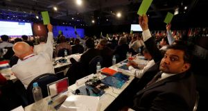 A member of Qatar's delegation (R) votes during the 65th FIFA Congress, held ahead of the 2014 World Cup, in Sao Paulo last week. Photograph: Paulo Whitaker/Reuters