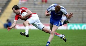 Tyrone's Justin McMahon claims possession ahead of Monaghan's  Kieran Hughes during the Ulster SFC quarter-final clash in Clones. Photograph:  Donall Farmer/Inpho