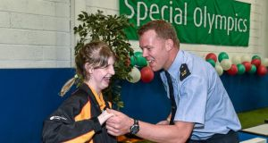 Bocce athlete Phoebe Dalrymple from Ballymena, Co Antrim dances with Garda Dermot Keating from Henry St Garda Station in Limerick after a medal ceremony. Photograph: Diarmuid Greene/Sportsfile