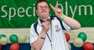 Team Leinster athlete Daniel Somers from  Rathfarnam, Dublin celebrates with his gold medal after winning the Bocce Division 17 singles competition. Photograph: Diarmuid Greene/Sportsfile