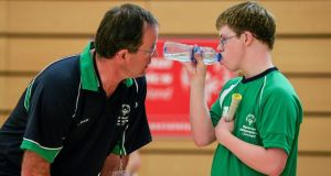 Badminton athlete Liam Foley from  Moate in Co Westmeath gets some advice from his coach Tommy Hehir  during half-time of his Division 8 game. Photograph: Diarmuid Greene/Sportsfile