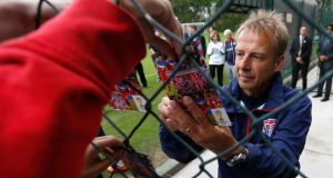 USA head coach Jurgen Klinsmann signs autographs for fans: Ghana have been the USA's nemesis in the last two tournaments. Photo: Kevin C Cox/Getty