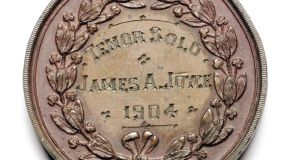 "The medal made by Dublin jeweller Edmond Johnson and engraved on the reverse with the lettering ""Tenor Solo James A. Joyce 1904""."