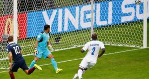 Goalkeeper Noel Valladares of Honduras and teammate Osman Chavez watch as Karim Benzema cannons off the bpost before bieng buindled over the line by the goalkeeper.  Photograph: Marko Djurica / Reuters