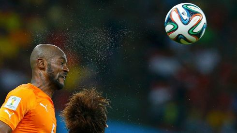 Ivory Coast's Didier Zokora (L) heads the ball during their 2014 World Cup Group C soccer match against Japan at the Pernambuco arena in Recife, June 14, 2014. REUTERS/Brian Snyder