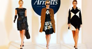 On the catwalk - Left: Raoul Francis Belted Dress, €400; Gala Leather Gloves, €160;Pour la Victoire Yves Tote, €435. Middle: Orla Kiely Camel Coat, €360; Marble Top, €280; Skirt, €260. Right: Raoul Ivory/black dress, €450; Raoul Ivory/black Coat    €655