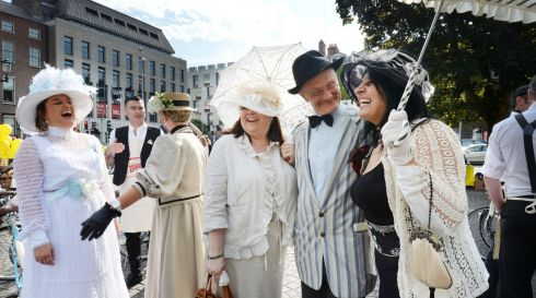 Alfreda Kavanagh,  Gail Wolfe, Paul Kennedy as James Joyce and Anina Marsella before joining the 150 cyclists who took part  in the 21st Annual Brennans Bloomsday Bike Rally for the Irish Youth Foundation, which got underway from Dublin's St. Stephens Green on Sunday.   Photograph: Alan Betson / The Irish Times