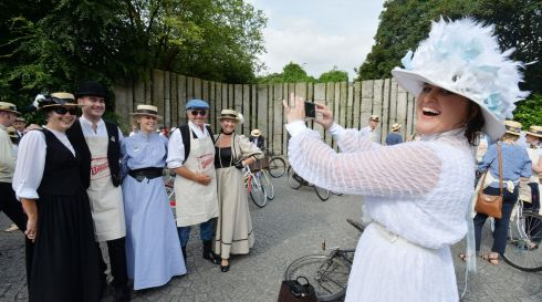 Alfreda Kavanagh, photographing Holly Fogarty, Ciaran Kavanagh, Anna May McGlynn, and Cathy O'Sullivan before joining the 150 cyclists who took part in the 21st Annual Brennans Bloomsday Bike Rally for the Irish Youth Foundation. Photograph: Alan Betson / The Irish Times