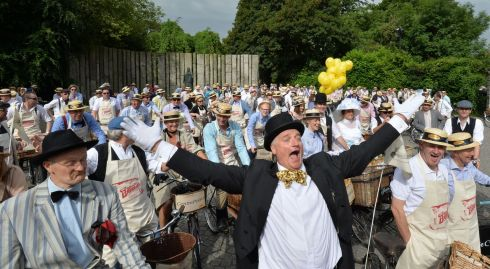 Grand Marshal Graham Wilkinson  and Paul Kennedy as James Joyce (left)  joined by 150 cyclists at St. Stephens Green, Dublin.  Photograph: Alan Betson / The Irish Times