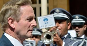Taoiseach Enda Kenny reviews guards at the government palace in Beirut, Lebanon, today. Photograph: Wael Hamzeh/EPA