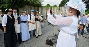 Alfreda Kavanagh, photographing Holly Fogarty, Ciarán Kavanagh, Anna May McGlynn, and Cathy O'Sullivan before joining the 150 cyclists who took part in the 21st annual Brennans Bloomsday Bike Rally for the Irish Youth Foundation in Dublin. Photograph: Alan Betson/The Irish Times