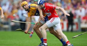 Cork's Damien Cahalane battles with Clare's Peter Duggan during the Munster senior hurling semi-final at Semple Stadium in Thurles. Photo: Cathal Noonan/Inpho