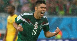 Mexico's Oribe Peralta after scoring the winner against Cameroon in their opening game at the Estadio das Dunas in Natal.