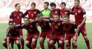 Russian national soccer team before their international friendly against Morocco at the Lokomotiv Stadium in Moscow. in this June 6, 2014 file photo.  Vasili Berezutski is pictured top right.