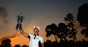 Martin Kaymer of Germany celebrates with the trophy  after winning the US Open Championship at Pinehurst, North Carolina. Photo: Andrew Reddington/Getty