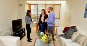Rental negotiator Angela McCabe with prospective renters husband and wife Guillaume and Blanche de Montalivet view an apartment for rent in The Hibernian Apartments, The Gasworks, Barrow Street, Dublin. Photograph: David Sleator
