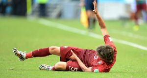Ouch! Portugal's Fabio Coentrao was left reeling by a freak injury during the defeat to Germany at the Arena Fonte Nova in Salvador. Photograph: EPA