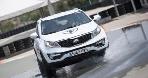 Get a grip: Firestone demonstrated its tyres on the Kia Sportage