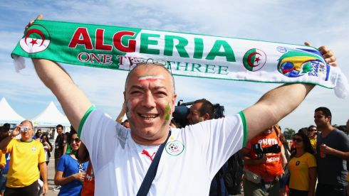 BELO HORIZONTE, BRAZIL - JUNE 17:  An Algeria fan enjoys the atmosphere prior to the 2014 FIFA World Cup Brazil Group H match between Belgium and Algeria at Estadio Mineirao on June 17, 2014 in Belo Horizonte, Brazil.  (Photo by Ian Walton/Getty Images)