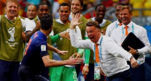 Robin van Persie of the Netherlands  celebrates his goal against Spain with coach Louis van Gaal at the Fonte Nova arena in Salvador. Photo: Michael Dalder/Reuters
