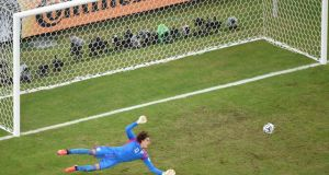 Mexico's goalkeeper Guillermo Ochoa dives to stop a shot during their  World Cup Group A  match against Brazil at the Castelao arena in Fortaleza. Photograph:  Francois Xavier Marit/Reuters