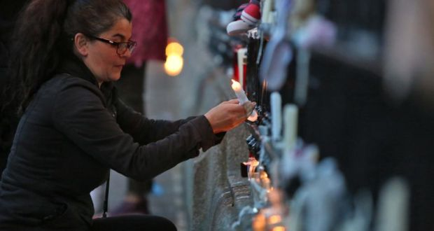 Candles are lit during a march from the Department of Children and Youth Affairs, Mespil Road to the Dáil, in solidarity with the babies and mothers from Tuam  and all other homes. Photograph: Colin Keegan