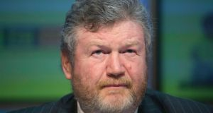 Minister for Health Dr James Reilly:  his  decision went much further than anyone expected, by backdating the reinstatement of discretionary medical cards to mid-2011. Photograph: Gareth Chaney Collins