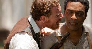 Michael Fassbender and Chiwetel Ejiofor in 12 Years a Slave. 'The film invited audiences to feel outrage against an aspect of history, then to savour the warmth that comes from the triumph of decency in the final reel. No prompt to face the fact of slavery remaining a reality for tens of millions today.'