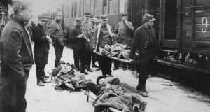 Wounded soldiers arrive at Rheims station from the western front during the first World War. Photograph: Topical Press Agency/Getty Images