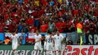 Chilean players celebrate in front of supporters after Charles Aranguiz made it 2-0 against Spain in the  World Cup  Group B match at  Estadio do Maracana in Rio de Janeiro. Photograph: Abedin Taherkenareh/EPA
