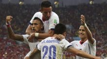 Chile send Spain crashing out of World Cup