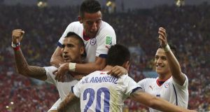 Charles Aranguiz of Chile (centre) celebrates with his team-mates after scoring to put his side 2-0 up against Spain in the  Group B  match at the  Maracana in Rio de Janeiro. Photograph: Antonio Lacerda/ EPA