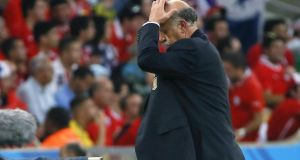 Spain's head coach Vicente del Bosque reacts during his side's  group B preliminary round match against Chile at the Estadio do Maracana in Rio de Janeiro. Photograph: EPA/JUANJO MARTIN