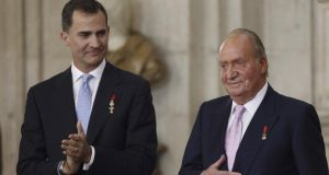 Prince Felipe and King Juan Carlos of Spain attend the official abdication ceremony at the Royal Palace in Madrid yesterday. The abdication took effect from midnight. Photograph: Getty
