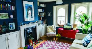 A painted fireplace gets a blue stencil frieze of triangles that picks out the another shade of the colour used on the walls in the room. The top of a side table gets the sgraffito treatment, a technique that was popularised during the Renaissance. Photographs: Fresh Style Hoffman and Stephen Devries