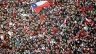 Chile fans celebrate victory over Spain  at a public screening in Santiago. Photograph: Eliseo Fernandez/Reuters