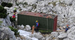 Rescuers stand next to a container during a rescue mission inside Riesending-Schachthoehle cave. The container offers protection from bad weather. Photograph: EPA